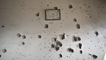 Evidence of firefight: A wall inside the school attacked by Taliban gunmen.