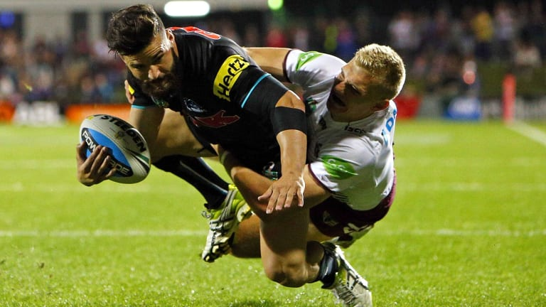 Josh Mansour of the Penrith Panthers scores a try in 2015. Several of the Panthers were star turns at the grand opening of the Masters hardware store at Penrith on January 16 but just 48 hours later it had been consigned to history along with the rest of Masters.