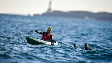 Swimmer Grant Siedle swims the 'Rip', with friend Eugene Docherty in the kayak.