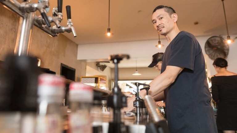 Geoff Bannister, at his Potts Point cafe, was pleased with the reduction in Sunday penalty rates.