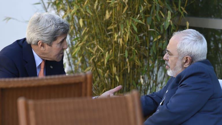 US Secretary of State John Kerry, left, talks with Iranian Foreign Minister Mohammad Javad Zarif in Geneva on Saturday.