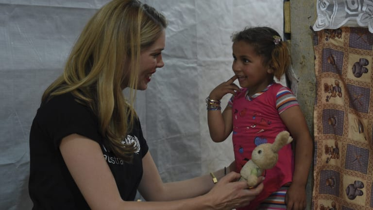 Tara Moss meets Reem, 4, for the first time in a UNICEF-supported early education program run for the children of seven informal settlements in the Bekaa Valley of Lebanon. There are more than 1500 informal settlements housing Syrian refugees throughout Lebanon.