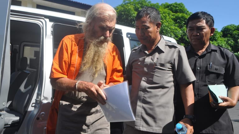 Robert Andrew Fiddes Ellis arrives at a Bali police station.