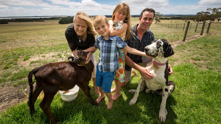 Lisa Cooper with her husband Troy, children Macey and Ben, and their pets.