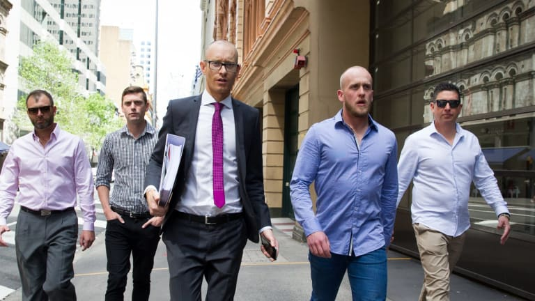 Shane Housego, Christian McDonald, Chris Sheehy and Steven Rapisarda join lawyer Nicholas Stewart (centre) to lodge papers at the NSW Civil and Administrative Tribunal in Sydney.