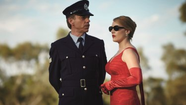 Woman in the red dress: Kate Winslet with Hugo Weaving in The Dressmaker.