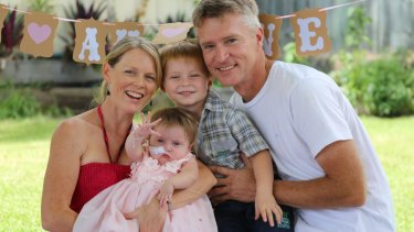 Glenn and Anthea Anderson and their son Lucas, 3, celebrating the first birthday of daughter Elise at their home on the Sunshine Coast of Queensland.