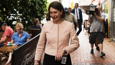 Gladys Berejiklian walks to her press conference this morning.