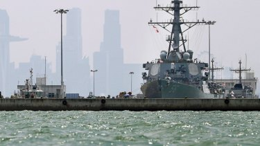 The USS John S. McCain is seen docked at Changi naval base after its accident.