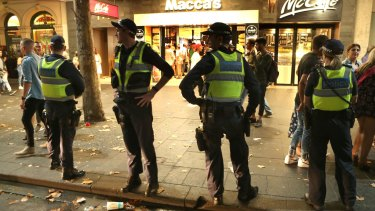 Swanston Street was awash with police officers in the early hours of Sunday morning.