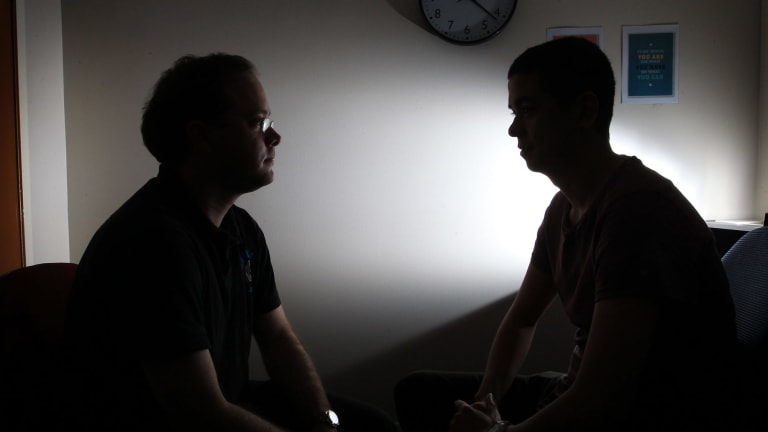 Mark (right) discusses his problems with a counsellor