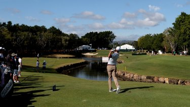 Picturesque: Scott tees off at the RACV Royal Pines Resort.