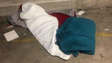 Workers sleep in bed rolls between shifts.