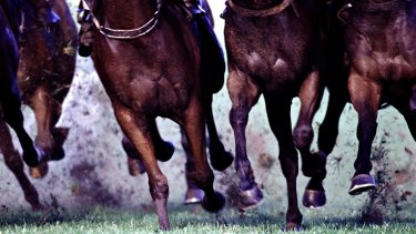 Tabcorp took a hit from its proposed merger with Tatts, legal battles and its new UK business.