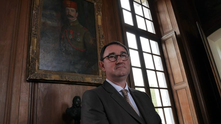 Monsieur Stanislas de Clermont-Tonerre poses next to a painting of his great-grandfather at Chateau Bertangles.