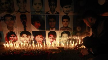 Sad times: A candelight vigil in Lahore for students killed in the school attack.