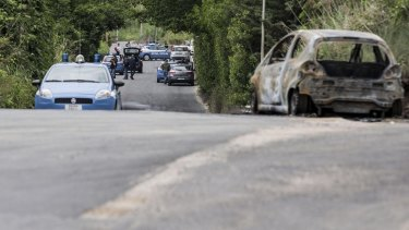 The burned car belonging to slain 22-year-old student Sara Di Pietrantonio is seen along a street in the outskirts of Rome.