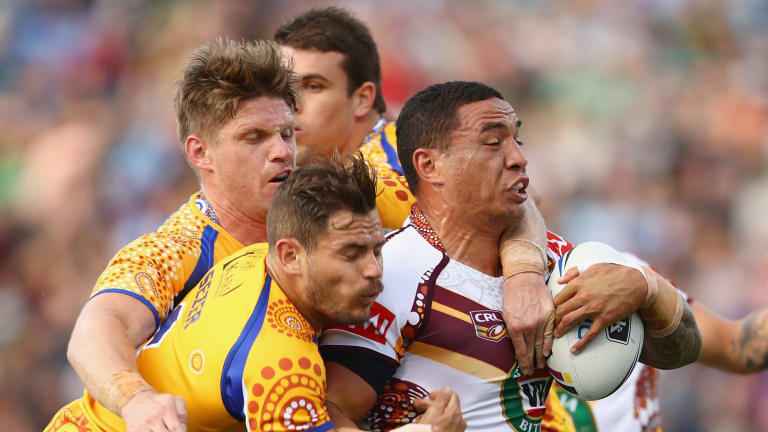 Held back: Tyson Frizell of Country is tackled by Chris Lawrence and Aidan Sezer.