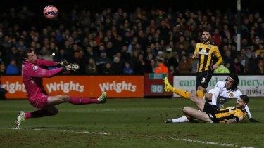 Job Dunn: Cambridge United's goalkeeper Chris Dunn denied Radamel Falcao.
