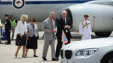 Their royal highnesses arrive at RAAF Base Edinburgh, South Australia. Prince Charles and General-General Sir Peter Cosgrove speak as do their wives Camilla Duchess of Cornwall and Lady Cosgrove.