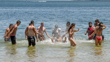 People flock to beaches to cool down after a burst of hot weather in Melbourne.
