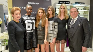 Mary and John Poulakis with models at the Tom Ford opening this month.