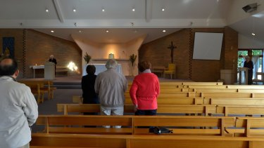 Parishioners attend morning mass at St Mary Magdalen in 2012, after Father Grasby was placed on leave.