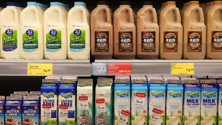 Cartons and bottles of milk products sit on display for sale