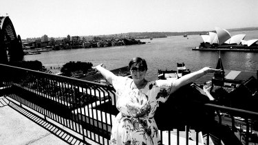 Mrs A. Gorrel admires the view from the 10th floor balcony of the new housing commission complex at The Rocks in Sydney, 19 March 1980.