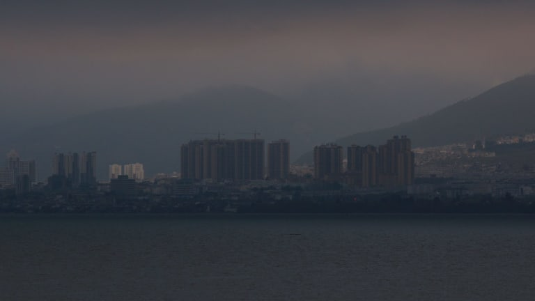 Apartments have popped up around Erhai Lake, polluting its waters.