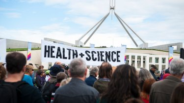 Protesters gather outside Parliament House for the March for Science.