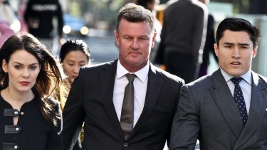 Anthony Bell arrives at court with his lawyers.