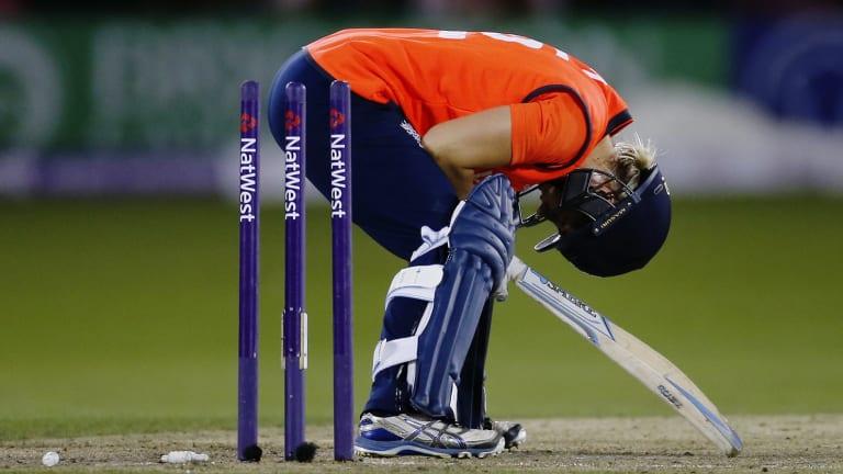 A shattered Katherine Brunt after she was bowled by Australia's Megan Schutt.