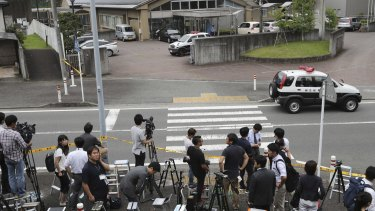 Journalists gather in front of Tsukui Yamayuri-en, a facility for the handicapped where a number of people were killed and dozens injured.