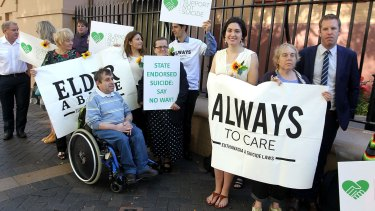 Campaigners gather outside Parliament on Thursday ahead of the debate on a bill to allow terminally ill patients over 25 to end their own lives in the Upper House.