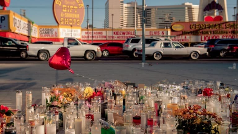 Candles replace revellers on a corner of Las Vegas Boulevard.