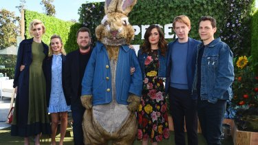 The cast of Peter Rabbit: Elizabeth Debicki, Margot Robbie, James Corden, Peter Rabbit, Rose Byrne, Domhnall Gleeson and Will Gluck in London earlier this month.