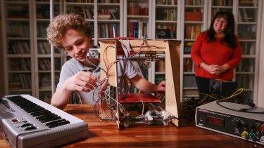 Gerardine Hansen with her son Hansen and the 3D printer he built.