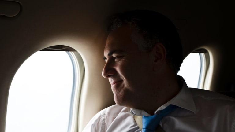 Treasurer Joe Hockey on board a private plane in 2013.