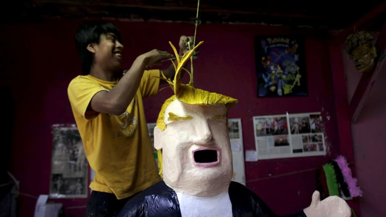 A worker hangs a pinata depicting US Republican presidential candidate Donald Trump at a workshop in Reynosa, Mexico.