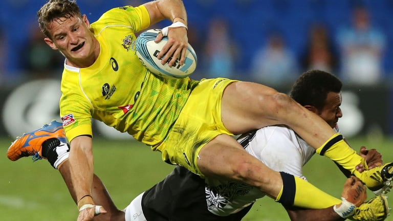 Con Foley of Australia is tackled by Sainivalati Ramuwai of Fiji during the Gold Coast Sevens in October.