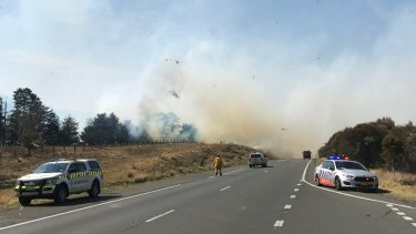 A grass fire is seen along the Hume Highway, north of Goulburn.
