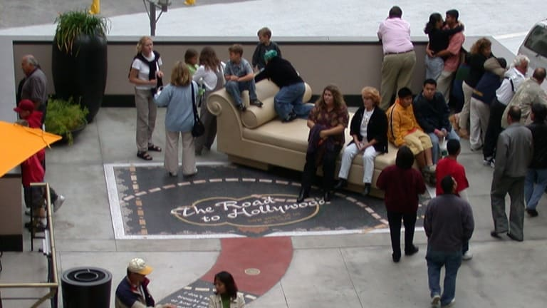 People using the sculpture/chair prior to its removal.