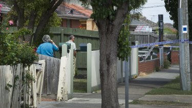 Neighbours look across to the scene from their front yard in Thomastown to the flat where Zvonimir​ Petrovski was killed.