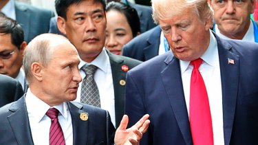 US President Donald Trump and Russia's President Vladimir Putin talk during a photo session at the APEC Summit in Danang, Vietnam.