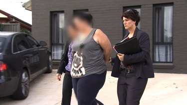 Department of Human Services employee Kristiane Soqosoqo is arrested at Blacktown.
