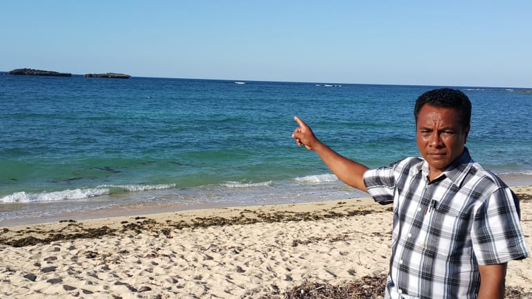 Semuel Messak, the head of Landu village in West Rote, where the Kanak came ashore, points to the rocks where the boat ran aground.