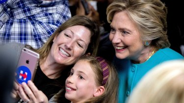 Feeling emboldened: Hillary Clinton gets a selfie with supporters.