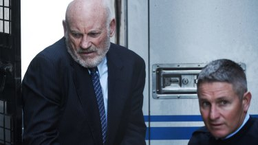 Ian Macdonald is led into the Supreme Court on Friday to be sentenced.