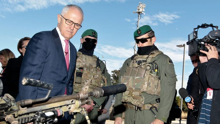 Prime Minister Malcolm Turnbull examines some military hardware during a media conference at Holsworthy Barracks.